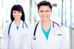 Young doctor with collegue Royalty Free Stock Image