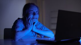 Young doctor crying working on laptop, stress from loss of patient, night shift. Stock footage stock footage
