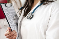 Young doctor. With documents and stethoscope Stock Images