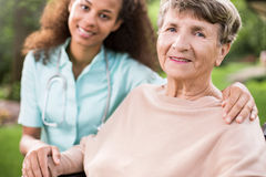 Young doctor and elder woman Stock Photography