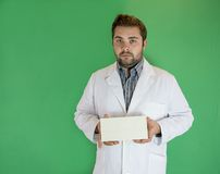 Young doctor with envelope Royalty Free Stock Photo