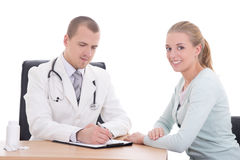 Young doctor explaining diagnosis to her female patient Stock Photos