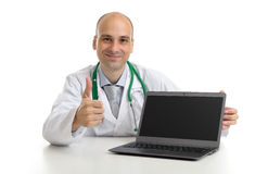 Young doctor expressing positivity. And smiling with thumb up royalty free stock photos