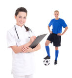 Young doctor and female soccer player in blue on white backgroun Stock Photography