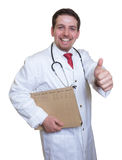 Young doctor with file of a patient showing thumb Royalty Free Stock Photo