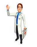 Young Doctor with first aid box Royalty Free Stock Photo