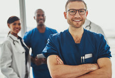Young doctor in front of team Royalty Free Stock Photography