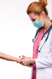 Young doctor give injection to caucasian arm. Young doctor give vaccine to caucasioan arm stock images