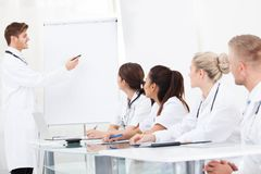 Young doctor giving presentation to colleagues Royalty Free Stock Photo