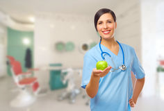 Young doctor with green apple Stock Photography