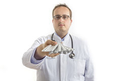 Young Doctor handing out Pills Royalty Free Stock Photos
