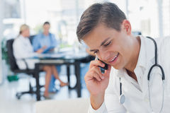 Young doctor having a phone call Stock Photography