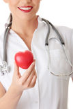 Young doctor with heart Royalty Free Stock Images