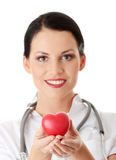 Young doctor with heart Royalty Free Stock Photo