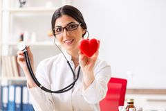 The young doctor in heart care concept. Young doctor in heart care concept royalty free stock photos