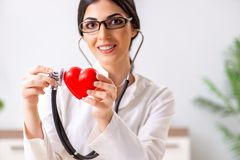 The young doctor in heart care concept. Young doctor in heart care concept royalty free stock photo