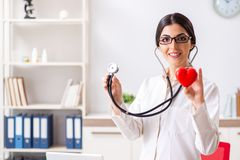 The young doctor in heart care concept. Young doctor in heart care concept royalty free stock photography