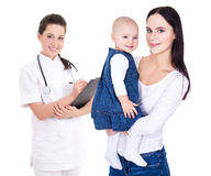 Young doctor and her patients mother with child isolated on whit Royalty Free Stock Images