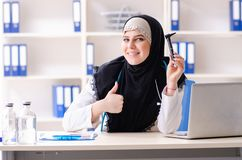 Young doctor in hijab working in the clinic. The young doctor in hijab working in the clinic royalty free stock photography