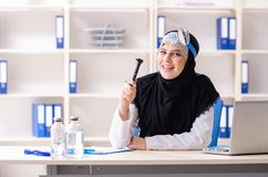 Young doctor in hijab working in the clinic. The young doctor in hijab working in the clinic stock image