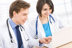 Young doctor and his collegue Royalty Free Stock Image