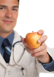 Young Doctor Holding a Apple Stock Photography