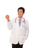 Young Doctor holding a apple with smiling Royalty Free Stock Image