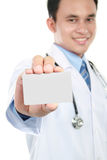 Young doctor holding business blank card Stock Photography