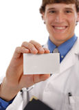 Young Doctor Holding Business Card Royalty Free Stock Images