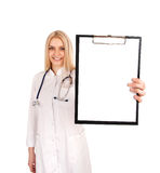 Young doctor holding clipboard Royalty Free Stock Photos