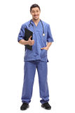 Young doctor holding a clipboard Stock Image