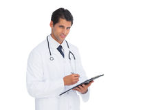 Young doctor holding a clipboard and pen Stock Photography