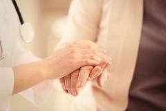 Free Young Doctor Holding Hands Of Old Woman, Royalty Free Stock Image - 105430126