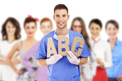 Young doctor holding letters a b c Royalty Free Stock Image
