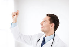 Young doctor holding something imaginary Stock Photos