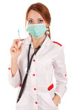 Young doctor holding syringe Stock Images