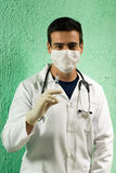 Young Doctor Holding Syringe - vertical Stock Photography