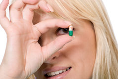 Young doctor holds capsule Stock Photo