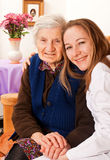 Young doctor holds the elderly woman hands Stock Photo
