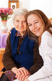 Young doctor holds the elderly woman hands Stock Photos