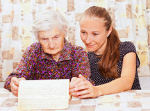 Young doctor holds the old  woman hand Stock Image