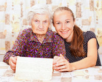 Young doctor holds the old  womans hand Royalty Free Stock Photo