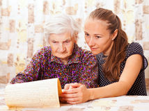 Young doctor holds the old  womans hand Stock Photos