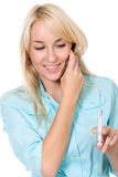 The young doctor holds a syringe Royalty Free Stock Image