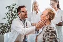 Young doctor during home visit senior people stock photos