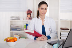 Young doctor informing about healthy nutrition. Royalty Free Stock Image