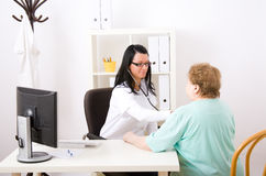 Young doctor inspect a patient Stock Images