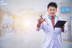 The young doctor intends to work in the back room Doctor hand working smart phone modern digital tablet laptop computer graphics c Stock Image
