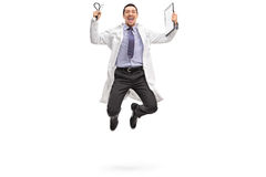 Young doctor jumping out of joy. Full length portrait of a young doctor jumping out of joy isolated on white background Royalty Free Stock Photography