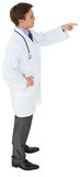 Young doctor in lab coat pointing Royalty Free Stock Images